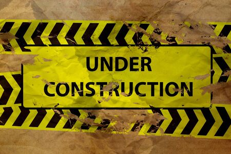 dangerous construction: under construction sign on paper  Stock Photo