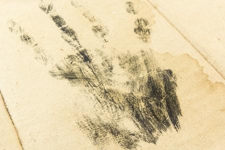 criminal investigation: handprint on old paper