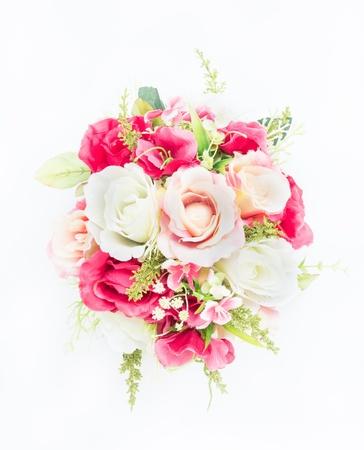 plastic flower on white background photo