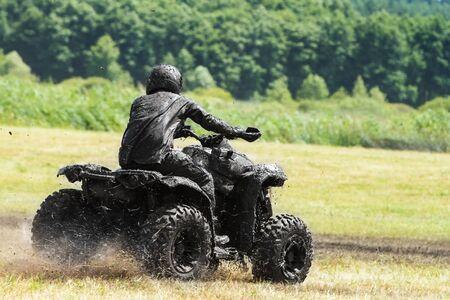 Racing on a dirt atv