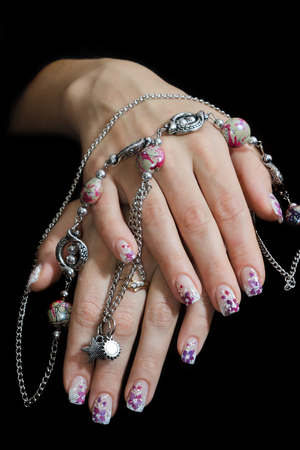 Beautiful female hands with manicure Stock Photo