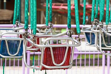 chain swing ride: Empty swing carousel in the Park