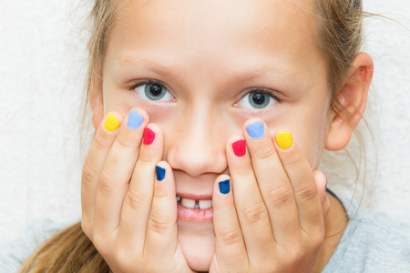 Daughter with manicure on hands, portrait
