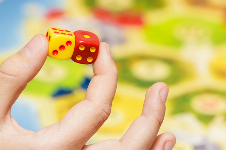 Childrens hand with dice from the board game