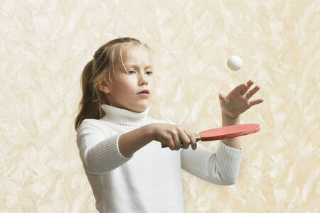 Child girl playing table tennis