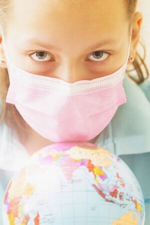Portrait of a girl in a mask with a globe.