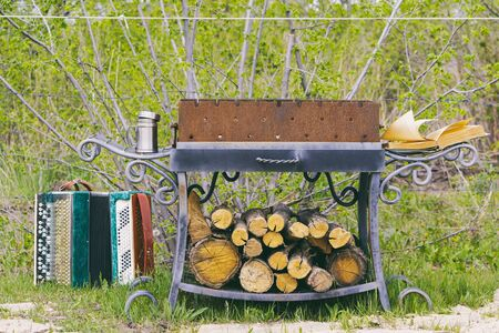 Place for cooking barbecue with firewood, a book and a accordion