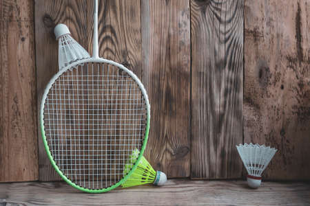 Sports equipment for bambinton on vinage wood background. Stock Photo