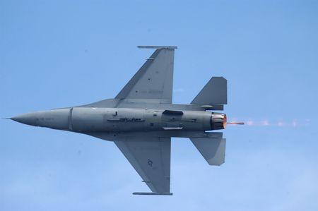 afterburner: F16 fighter jet with afterburner on.
