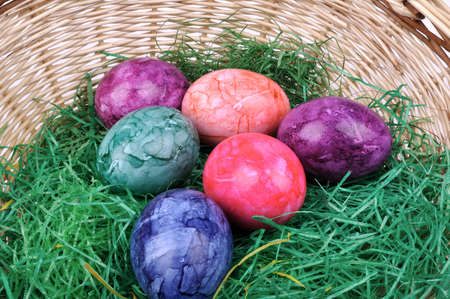 Colorful Easter eggs in one basket photo
