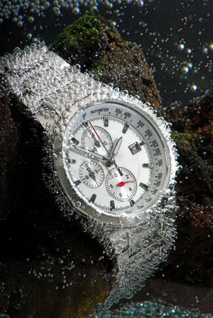 chronograph: waterproof sports chronograph watch under water bubbles on it, macro Stock Photo