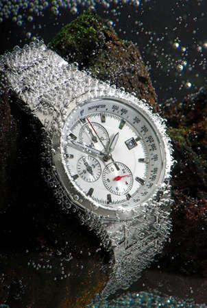 wrist strap: waterproof sports chronograph watch under water bubbles on it, macro Stock Photo