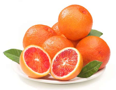 cut and blood: composition of blood oranges on a plate, isolated on white, clipping path provided