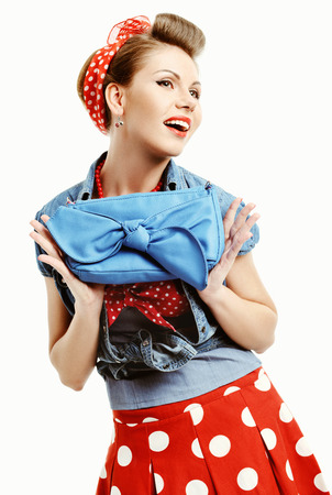 Pin-up young woman in vintage American style with a clutch photo