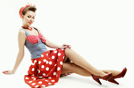 skirt up: Pin-up young woman in vintage American style