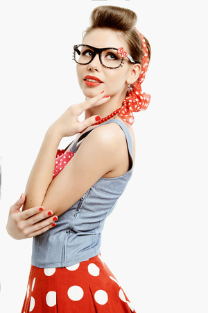 Pin-up young woman wearing glasses in vintage American style photo