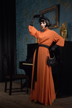 vamp: Actress in long dress at retro style