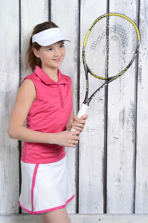 tennis skirt: Young girl is ready to play tennis