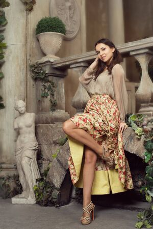 studioshoot: Young beautiful woman in flower skirt at Italian pation