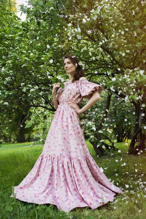 pink dress: Young beautiful woman in pink dress at the garden Stock Photo