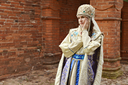 stoop: Young beautiful woman in traditional Russian costume Stock Photo