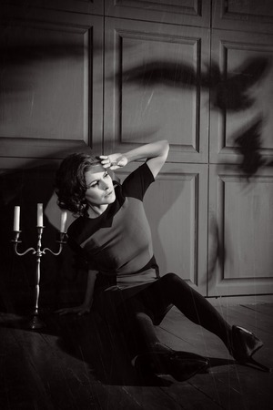 dismay: Young woman in horror movie at black and white Stock Photo