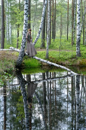 brich: Young beautiful girl in the summer forest