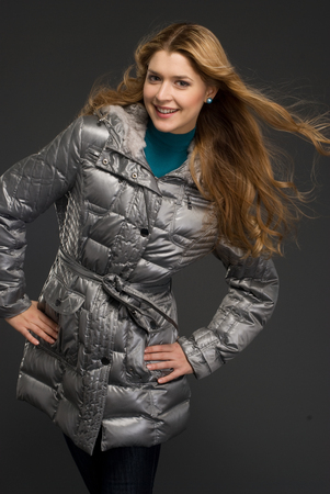 athletic wear: Young beautiful woman at studio in winter clothes
