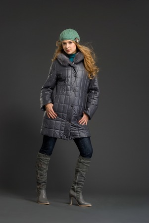 outer clothing: Young beautiful woman in winter clothes at studio