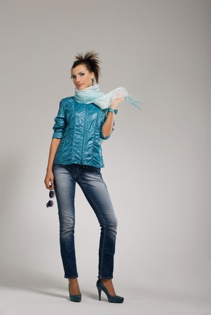casual wear: Young woman posing at casual wear in studio Stock Photo