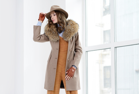 Young girls in coats posing at stidio Stock Photo