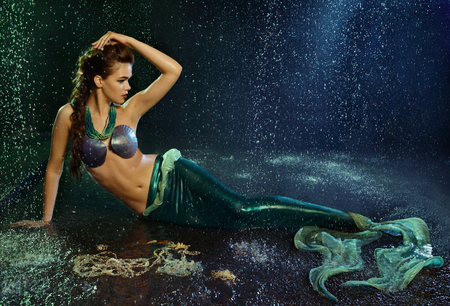 siren: Young beautiful  girl at the image of mermaid Stock Photo
