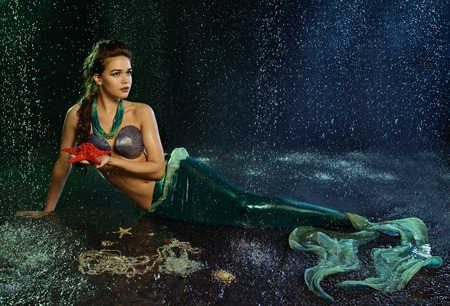 Young beautiful  girl at the image of mermaid Stock Photo