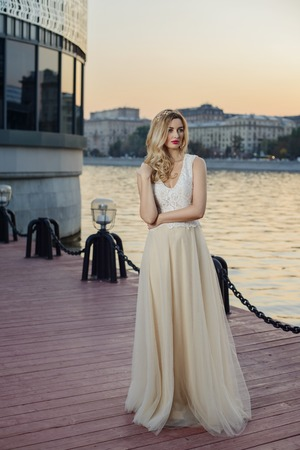 beauties: Beautiful girl at the river bank in the city Stock Photo