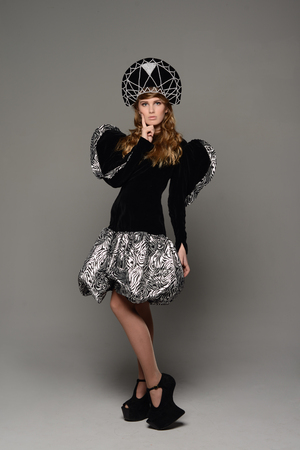 glam rock: Young beuatiful girl in th dress of Russian style