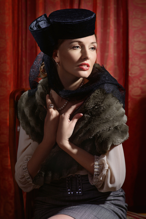 20s: Beautiful young actress in classic 20s interior
