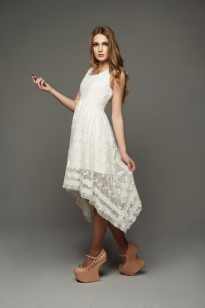 glam rock: Young beautiful girl in unusual lace dress