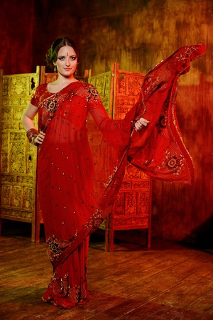sari: Young beautiful girl in red Indian sari