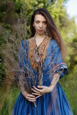 brich: Young gipsy in blue dress at the forest Stock Photo
