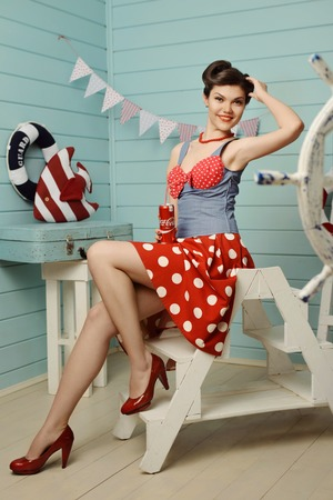 Young beautiful girl dressed at pin-up style Stock Photo