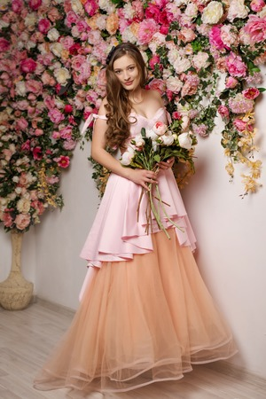 Young beautiful girl at the flower interior Standard-Bild