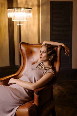 century: Young beautiful woman in long silk dress