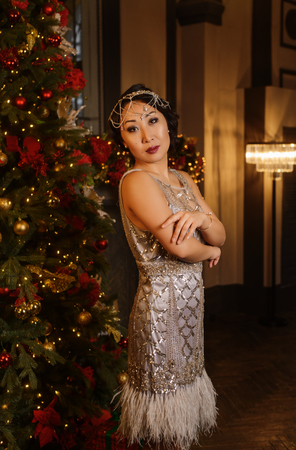 Beautiful lady in silk dress at art deco style