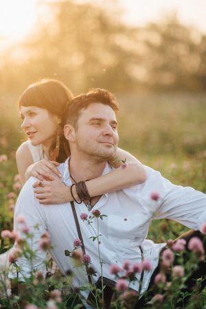 Love story of young couple at nature Stock Photo