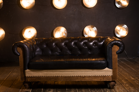 Black leather sofa in loft interior