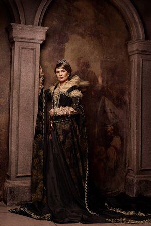 Mature woman in costume of queen