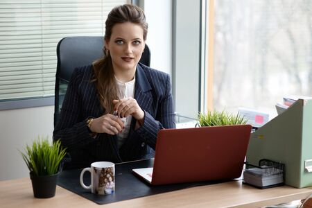 Business woman dressed in elegant style
