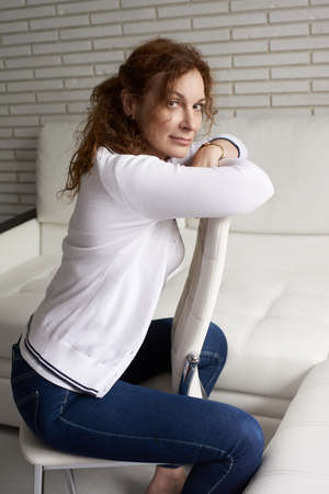 Mature business woman have a rest in home