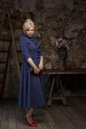 Attractive mature woman wearing blue dress