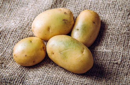 Sunlight and warmth turn potatoes skin green witch contain high levels of a toxin, solanine which can cause sickness and is poisonous. Do not buy and eat green potatoes! Heap on sackcloth.